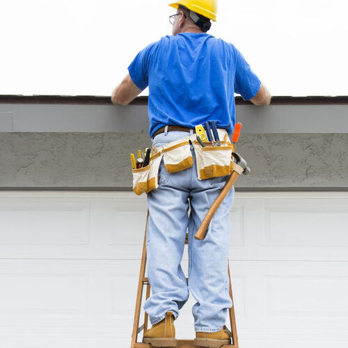 A Roofing Professional Inspects a Roof.