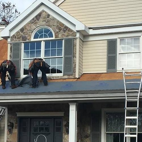 Roofers Work on Repairs.