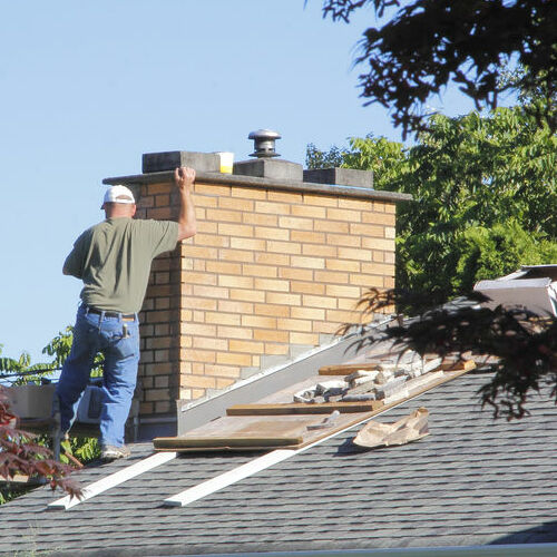 A Roofer Works on Repairs.