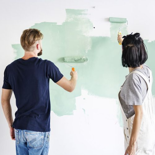 Couple Renovating House With Painting
