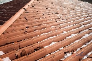 damaged clay tiles from hail storm