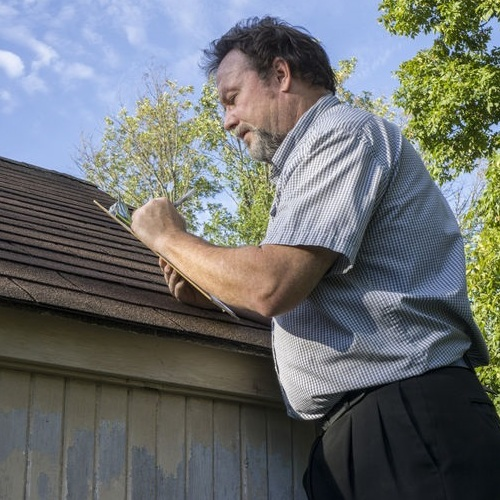 An Roof Inspector Goes Through His Checklist